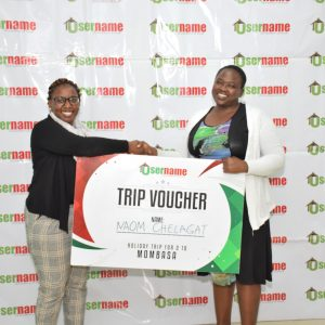 Username Investment Ltd. Marketing Manager left awarding Naom Chelagat right a trip voucher for 2 to Mombasa after she emerged a winner in the recently held Christmas Campaign Draw. www.businesstoday.co.ke