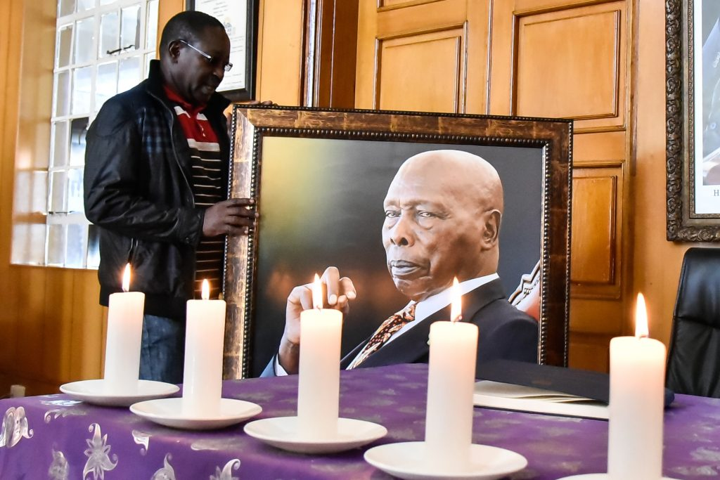 David Namu setting up the iconic portrait of the late President Daniel Moi at Kabarak. Namu was one of the late president's favourites from the battery of journalists covering his events. www.businesstoday.co.ke