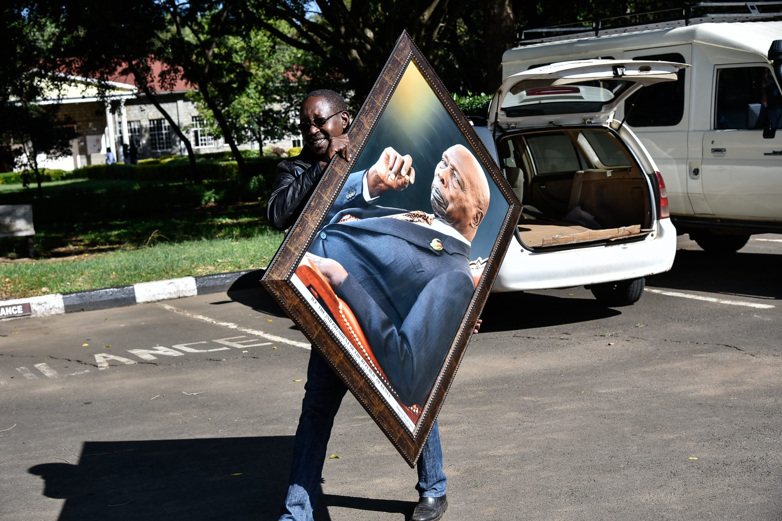 David Namu delivering the iconic portrait of the late President Daniel Moi. Working as a photographer, Namu became one of the late president's favourites from the battery of journalists covering his events. www.businesstoday.co.ke
