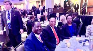 Raila Odinga with President Uhuru Kenyatta and his daughter Rosemary at the prayer breakfast in Washington DC, USA. Raila has not been able to pay his last respects to the late President Daniel Moi in person. www.businesstoday.co.ke