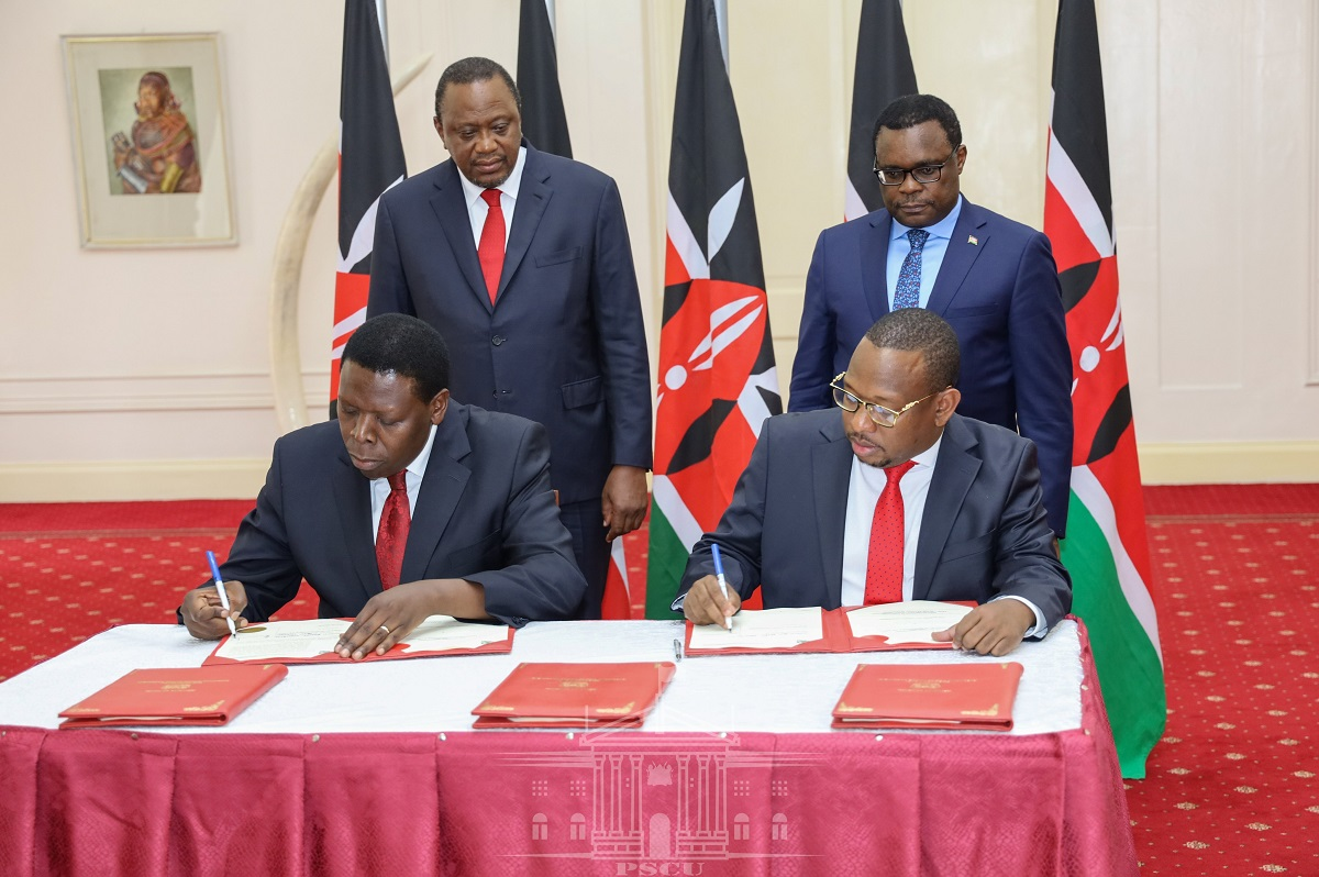 Mike Sonko signs the documents to surrender some functions of the county to the national government. Questions abound if the exercise was legal. www.businesstoday.co.ke