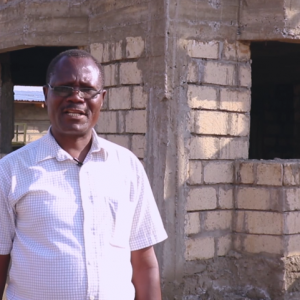 Hezron next to his home after investing in affordable plots in Ngong. www.businesstoday.co.ke