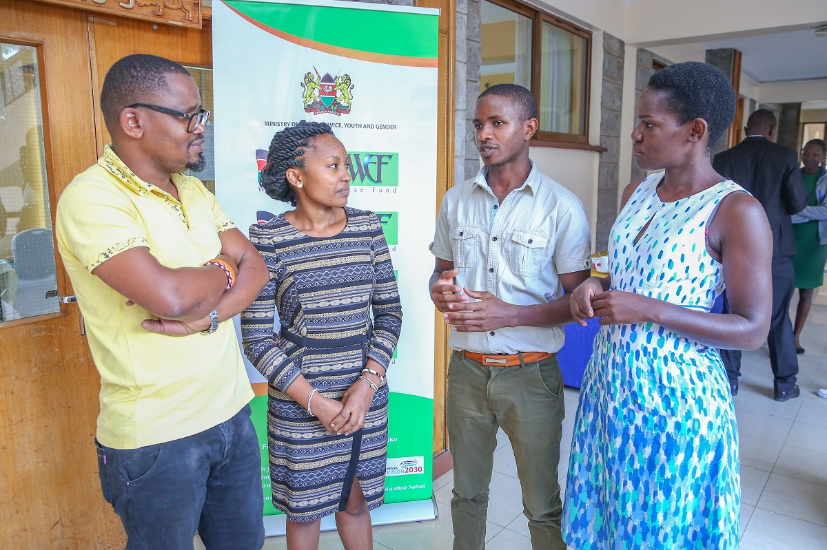 WEF Head of Monitoring &Evaluation, Collins Okoth (L) and Communication manager Ruth Randa (Right) dialogues with Trainers Rhoda Njeri and Timothy Hinga during the Training for Trainers session held at the KICD Centre in Nairobi on Thursday. www.businesstoday.co.ke