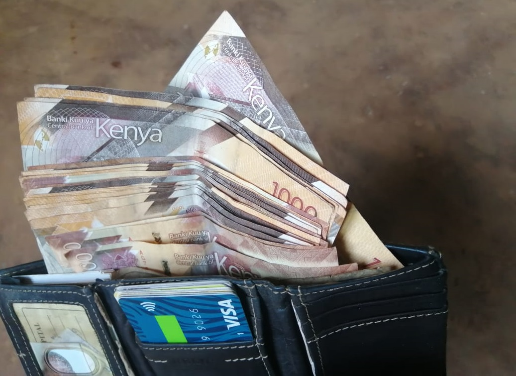 Notes in a wallet. Many Kenyans turned to entrepreneurship following the onset of the Covid-19 pandemic.