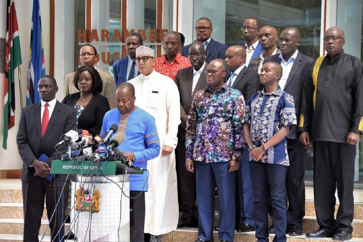 Health CS Mutahi Kagwe flanked by other CS when he announced that Kenya had confirmed its first coronavirus case in March. The Ministry has ordered 24 million doses of the vaccine.