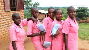 School girls with free pads. The #AchieveMoreGirl project seeks to reduce school absenteeism among adolescent girls during menstruation by promoting menstrual health and access to products. www.businesstoday.co.ke