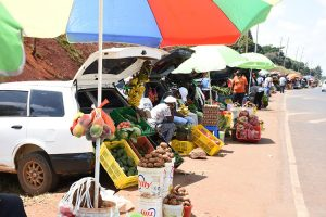 Kenyans pictured selling fruits and vegetables out of their cars