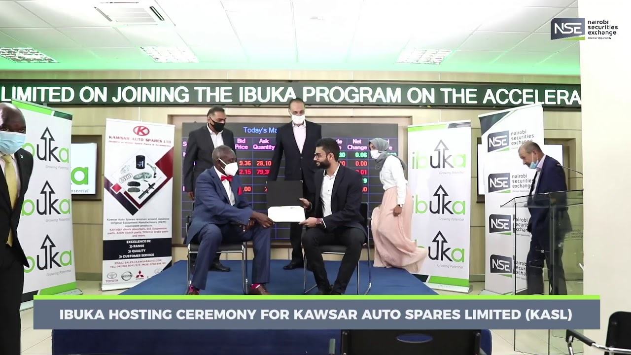 Kawsar Auto Spares officials pictured at a ceremony welcoming the company to the Ibuka program