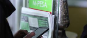 File image of an M-Pesa user