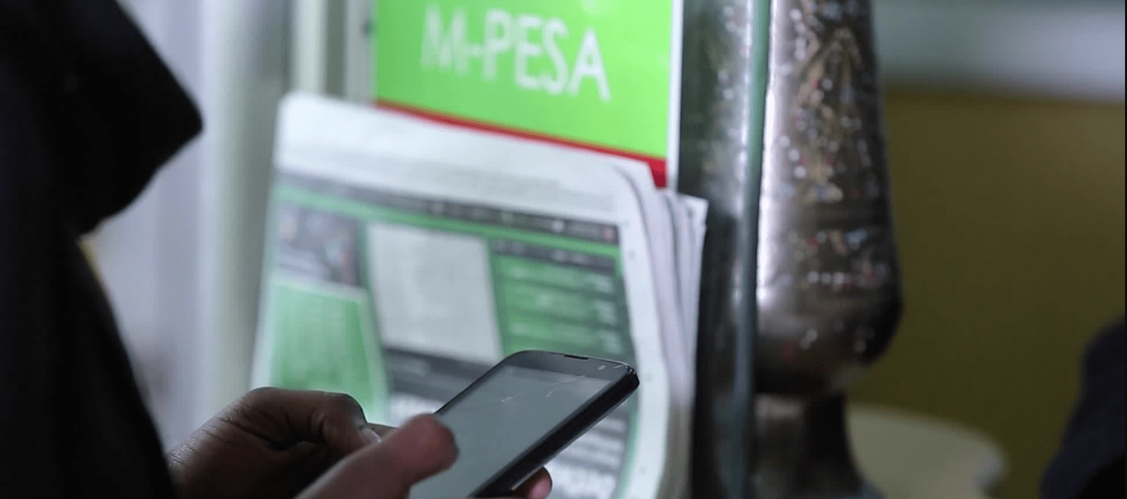 File image of an M-Pesa user