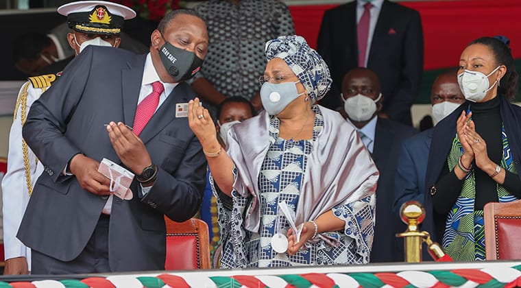 President Uhuru Kenyatta and First Lady Margaret Kenyatta look at their Huduma Namba sample cards at Gusii Stadium, Kisii on October 20