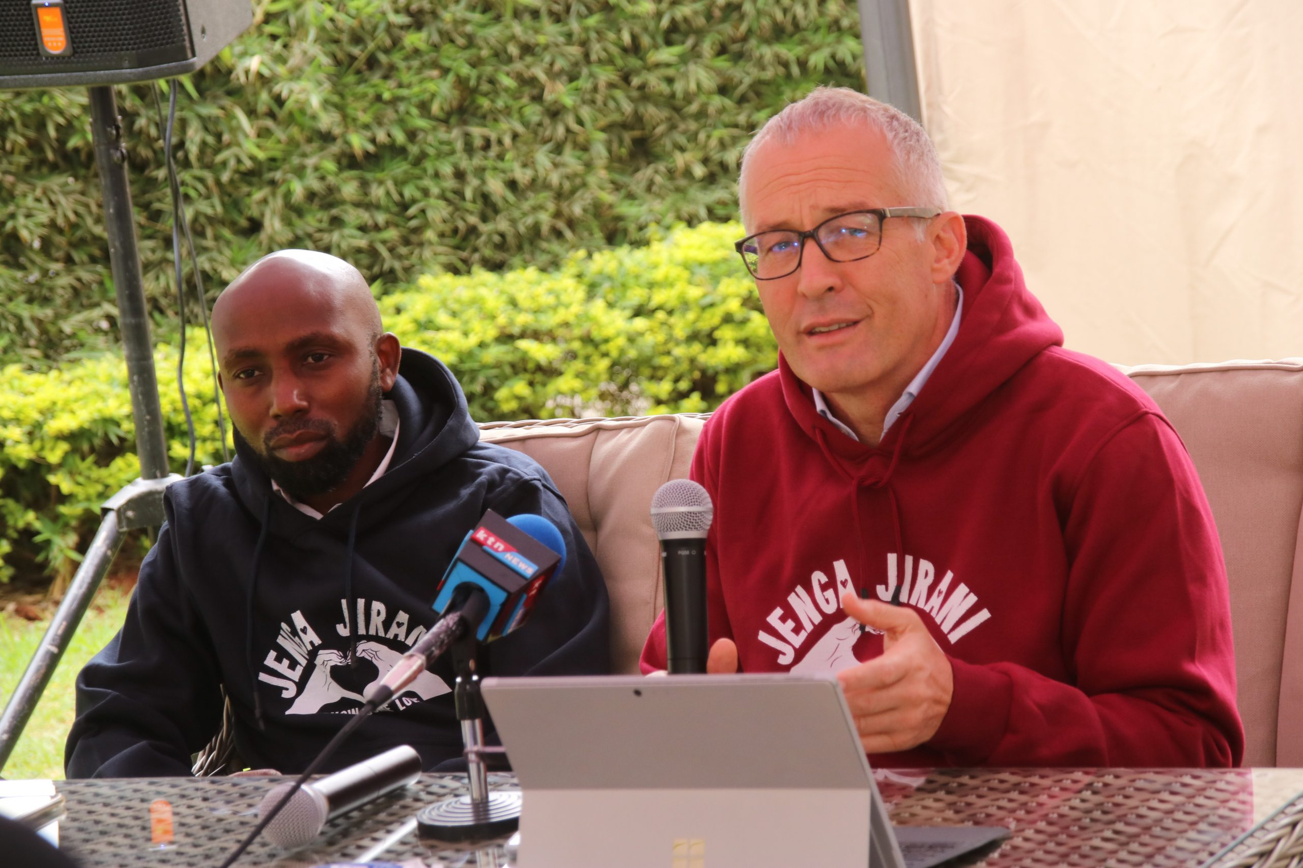 Moses Mathenge (DJ Moz) and JJF Chairman Jonathan Jackson at a media event for Jenga Jirani Festival