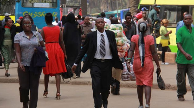 Kenyans pictured walking in Nairobi