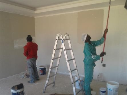 Painters at work. Basco Paints has relaunched a loyalty program to cushion painters in Kenya during the pandemic.