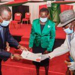 President Uhuru Kenyatta handing over a title deed to a member of the Samburu community as Lands Cabinet Secretary Farida Karoney looks on at a past function.