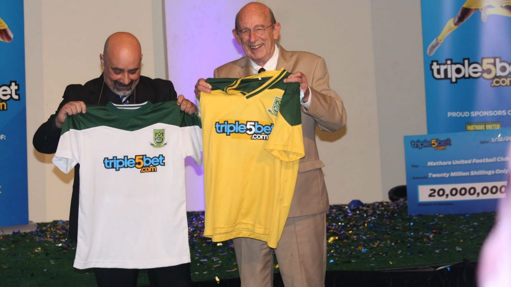 Mathare United Chairman Bob Munro (right) poses with a Triple5 Bet official after the company was unveiled as Mathare's shirt sponsors for the 2020/21 season on December 1, 2020. Mathare United is among clubs that have refused to endorse FKF's media rights deal with Startimes.