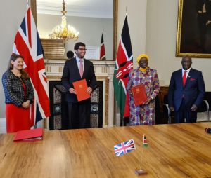 Kenya and UK officials pose after signing a free trade deal on December 8, 2020