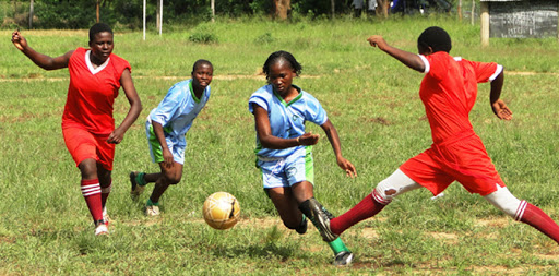 Girls playing football for Moving the Goalposts (MTG), a women's rights organization in Kilifi County. MTG is featured in Facebook's 'Real People Real Stories' campaign.