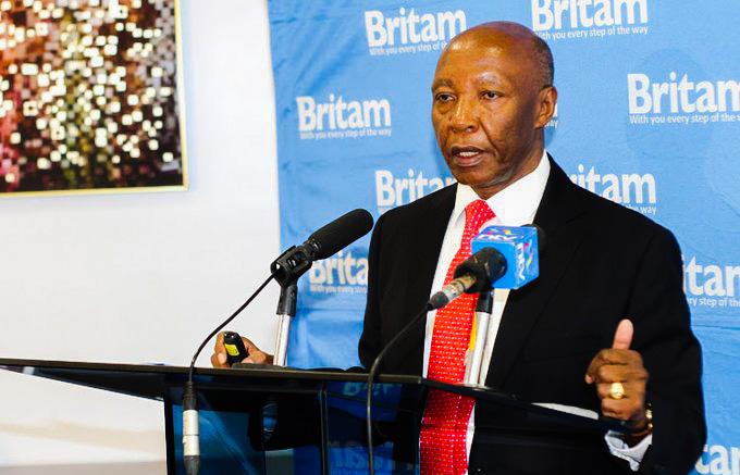 Britam CEO Benson Wairegi addressing a past press conference