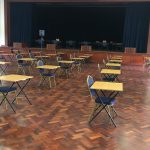 An auditorium at Peponi School with socially distanced desks.