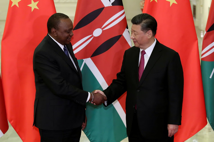 Kenyan President Uhuru Kenyatta shakes hands with Chinese President Xi Jinping before the meeting at the Great Hall of People in Beijing, China on April 25, 2019. Kenzaburo Fukuhara/Pool via REUTERS