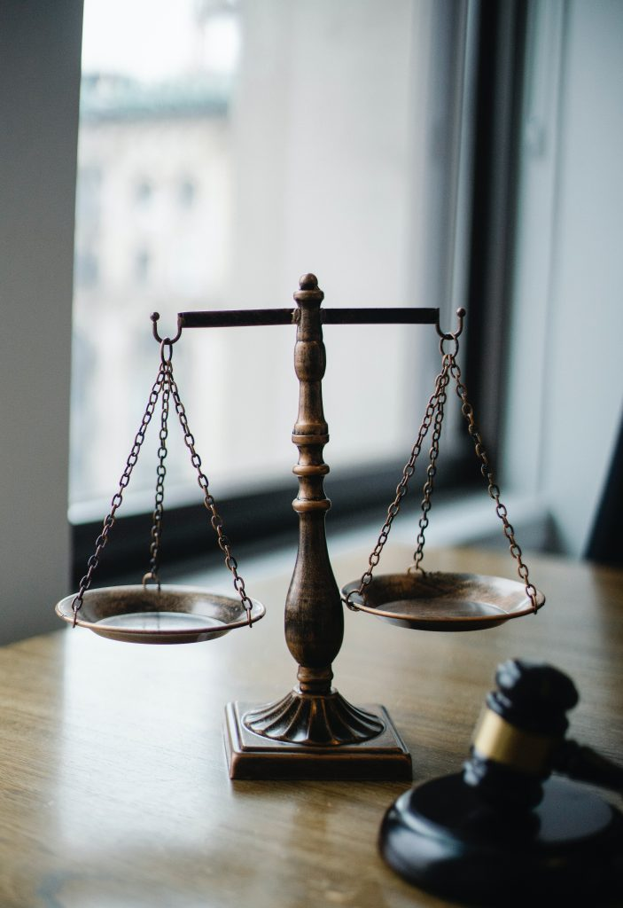 Image of a gavel and a scale