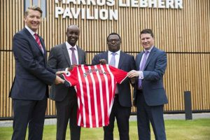 Paul Ndung'u (second from right) and Sportpesa CEO Ronald Karauri (third from right) during the unveiling of a past sponsorship deal with Southampton FC in 2016.