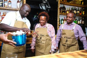 (L-R)Joel Kamau, KBL Commercial Director pours Yvonne Mwangi, EABL Head of Sales Nairobi a drink as Nick Mutinda, EABL Head of Reserve(Luxury) and Key Accounts looks on at the launch of the Diageo Bartenders Academy at K1 Johnnie Walker Bar.