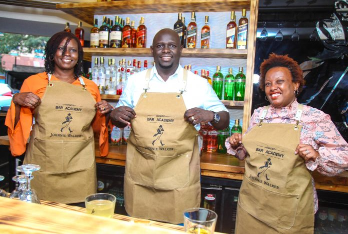 (L-R) Flavia Othim, KBL Head of Spirits, Joel Kamau, KBL Commercial Director with Yvonne Mwangi, Diageo Global Sales Execution Lead Africa at the launch of the Diageo Bartenders Academy at K1 Johnnie Walker Bar. The Academy intends to train 10,000 bartenders in the country over the next four months.