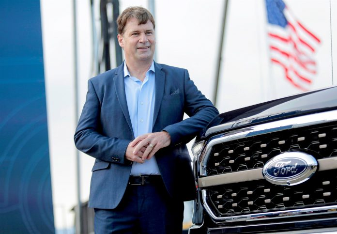 Ford Motor Co. CEO Jim Farley poses next to a new 2021 Ford F-150 pickup truck at the Rouge Complex in Dearborn, Mich., on Sept. 17, 2020.