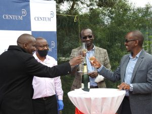 Heri Homes CEO Kimotho Kimani (in black Jacket) and Centum Re MD Sam Kariuki (right) toasting during the Cascadia Open Day at Two Rivers on February 24, 2021