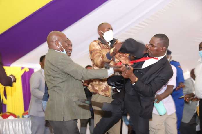 Mps fight at funeral
