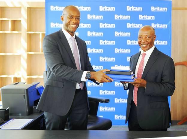 Benson Wairegi (right) hands over to new Britam Holdings Plc Managing Director Tavaziva Madzinga on February 1, 2021.