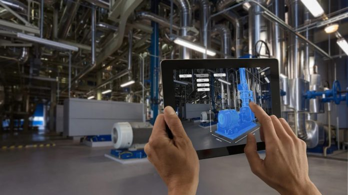A factory worker using Augmented Reality (AR) technology