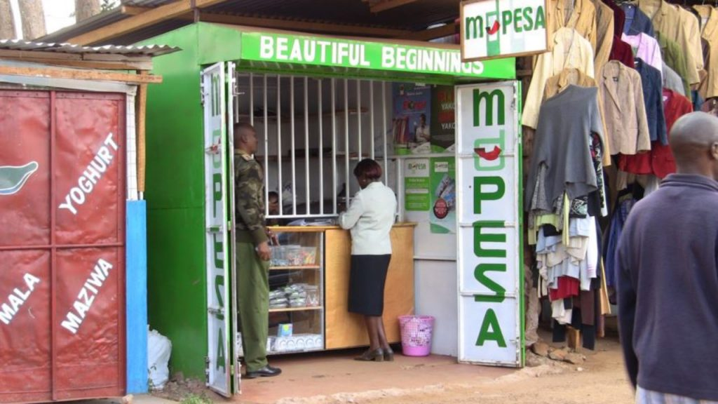 Customers at an M-Pesa agent outlet in Nairobi