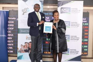 NSE CEO Geoffrey Odundo and NRSA boss Zuhura Ogada pose after signing an MoU on February 17, 2021 that will see the bourse join the 30% club.