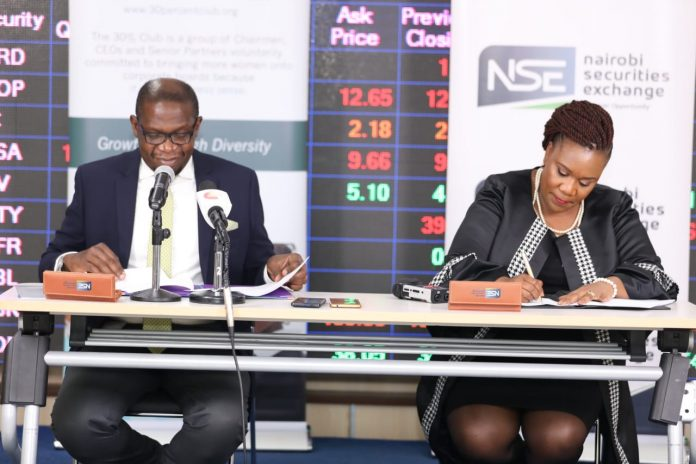 NSE Chief Executive Officer Geoffrey Odundo (left) and NRSA CO Zuhura Ogada sign an MoU that will see the bourse join the 30% Club