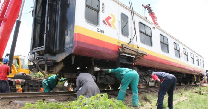 Technicians work on a train on the Nairobi-Nanyuki line. Passenger trains from Nakuru-Kisumu are set to begin operations later this year.