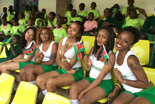 Safaricom models pose with Kenyan flags at a past sporting event. A new report has revealed 100 brands most loved by women in Kenya.