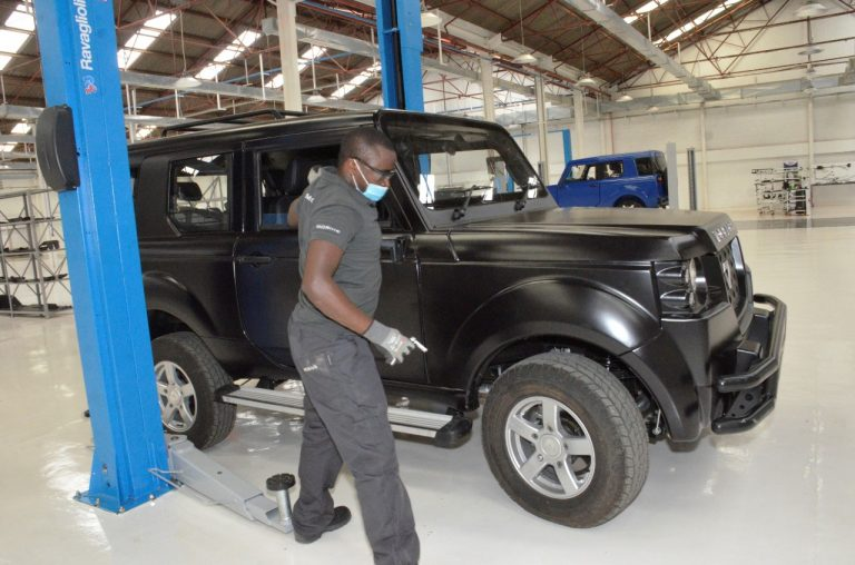 A staff member works on a vehicle at Mobius Motors' new plant in Nairobi