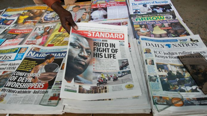 Newspapers displayed at a stand in Kenya. Auctioneers have flooded local dailies with loan defaults on the rise.