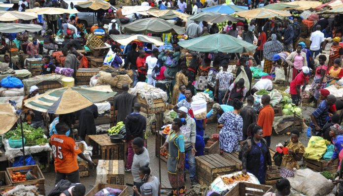 Traders at an open-air market. Globally, 58 per cent of employed women work in informal employment, and estimates suggest that during the first month of the pandemic, informal workers globally lost an average of 60 per cent of their income.