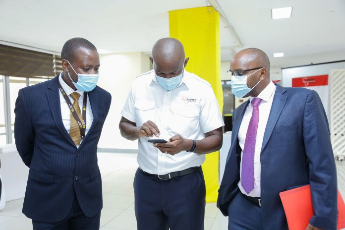 The Managing Director of National Bank of Kenya, Paul Russo (right) with Amref Flying Doctors CEO, Stephen Gitau during the launch of Maisha Cover Emergency Service in partnership with Amref Flying Doctors. Looking on is NBK's Head of Change Management, Fred Kioko.