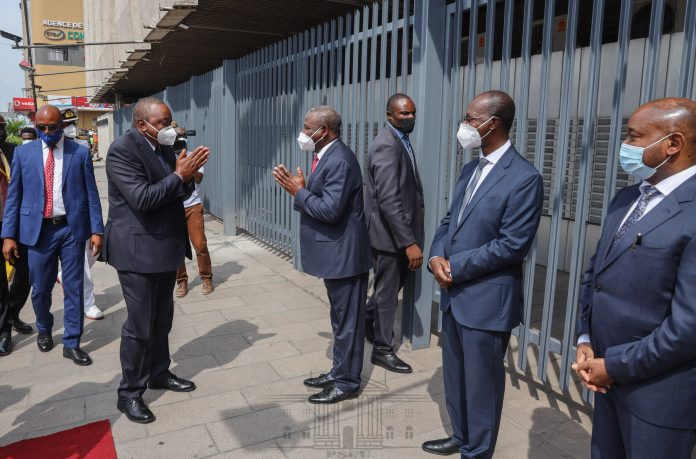 President Uhuru Kenyatta and Equity Group CEO James Mwangi unveiling the bank's new headquarters in Kinshasa, DRC following its merger with BCDC. It will serve as the hub for further expansion into Central Africa.