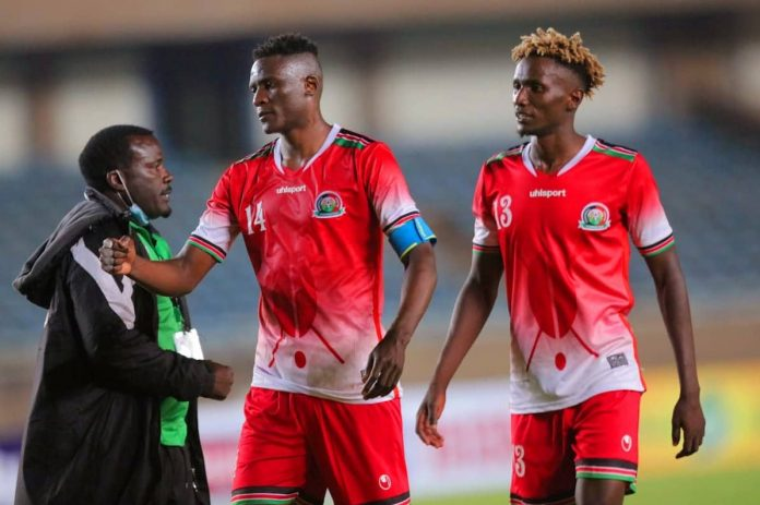 Harambee Stars' Michael Olunga (l) and Kenneth Muguna after an AFCON Qualifying match vs Egypt on March 25, 2021. For players plying their trade in local leagues such as Gor Mahia midfielder Muguna, the second lockdown has had an unwelcome impact. (Photo: Kenneth Muguna)