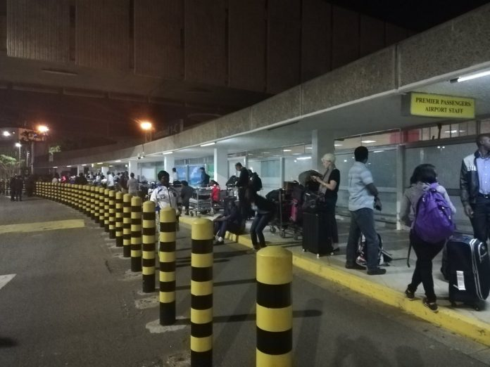 Passengers at the Jomo Kenyatta International Airport. The US has issued a level 4 travel advisory warning its citizens not to travel to the country.