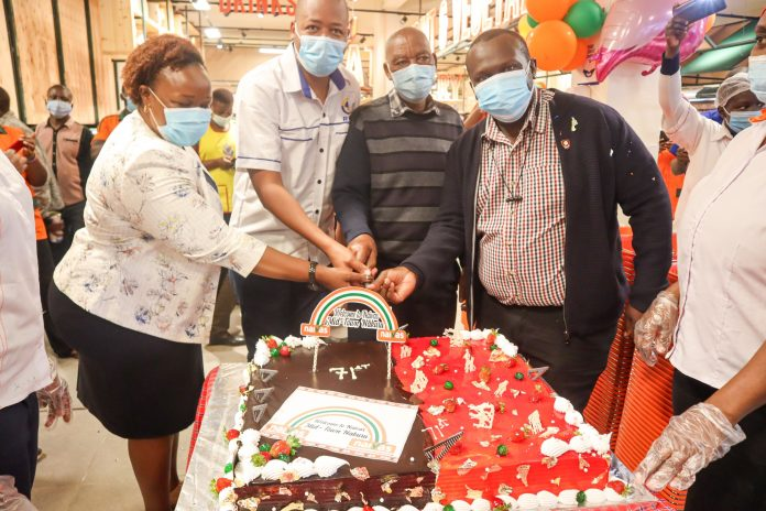 A cake is cut to celebrate the opening of Naivas' 71st store. The store in Nakuru represents a dream come true for the supermarket chain which started with a small store in Rongai, on the outskirts of Nakuru.