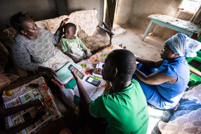 Residents in a rural area using smartphones. One of the countermeasures to address rural decline is for tech companies to recognise that talent can operate from anywhere and provide employees the option of working from anywhere. (Photo: OneAcre Fund)