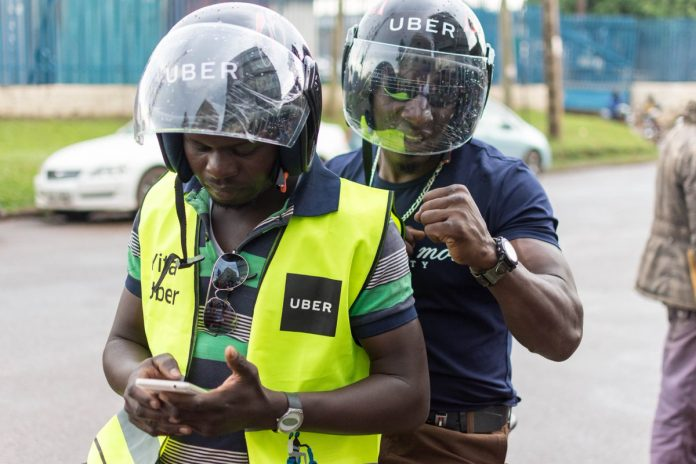 An UberBoda rider with a client. The launch of electric motorcycles and scooters is a first for Uber in Sub-Saharan Africa.