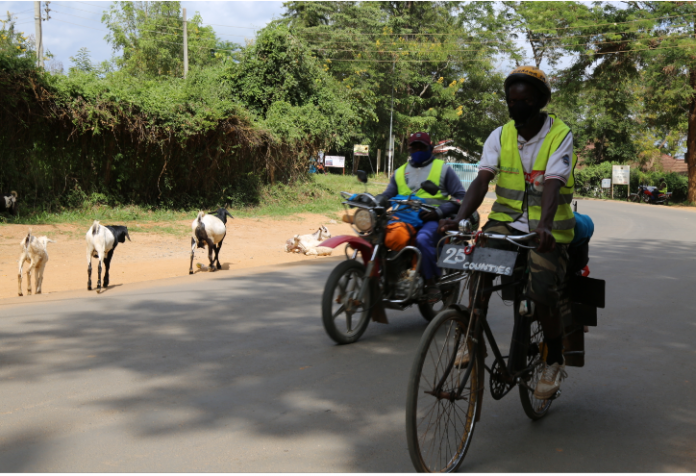 Fredrick Ochieng cycles on Covid-19 campaign